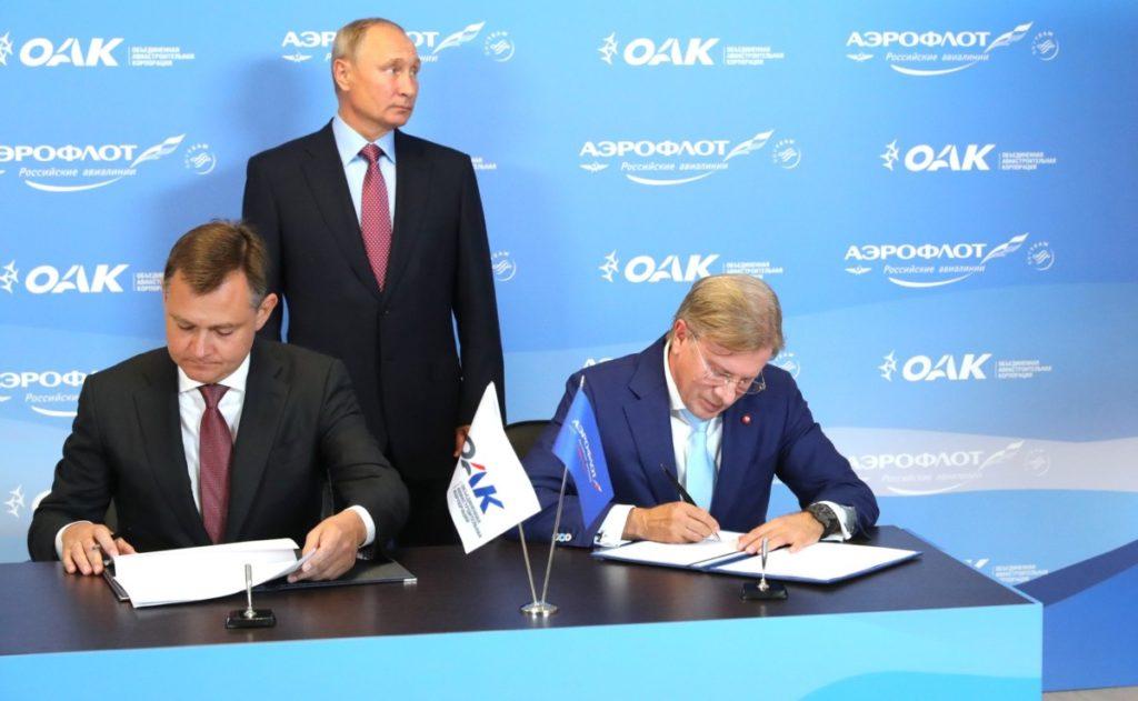 Avtalen undertegnes av Vitaly Savliev og Yury Slyusar