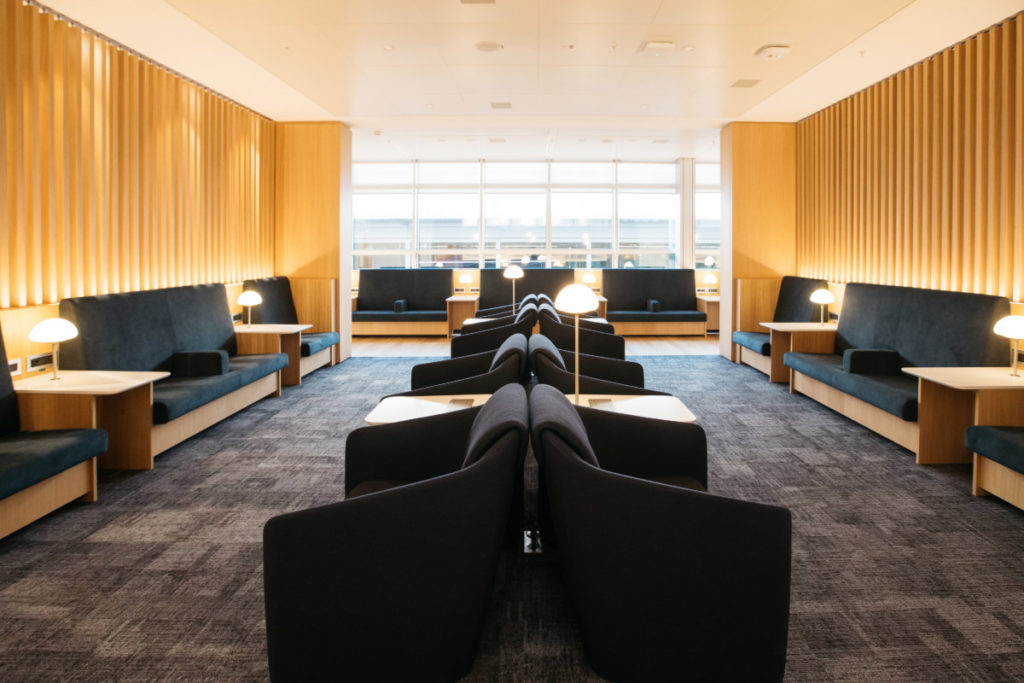 The area offers a varied selection of chairs and seating areas suitable for both work and relaxation.