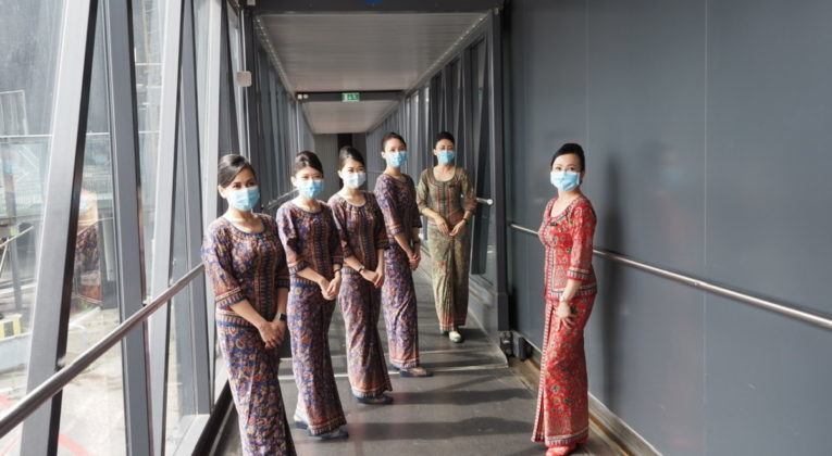 singapore airlines - cabin crew with ppe